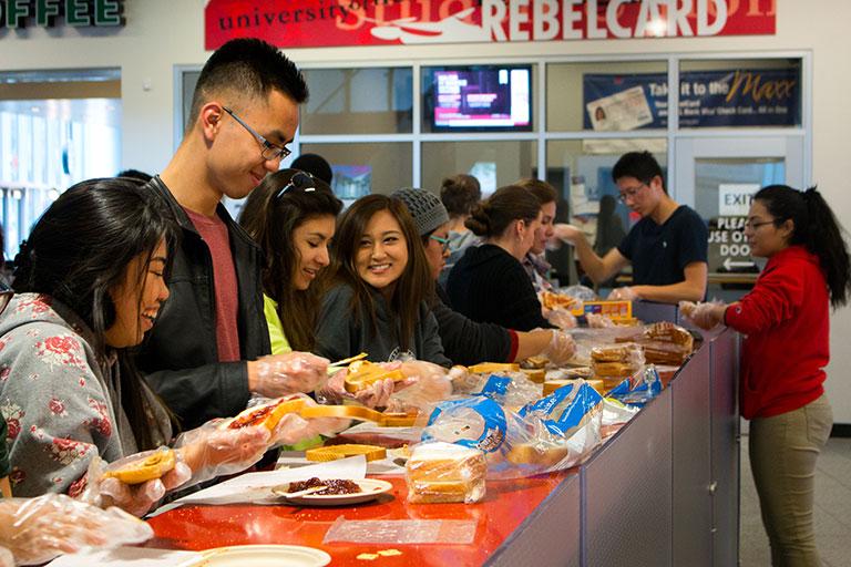 Volunteers making sandwishes