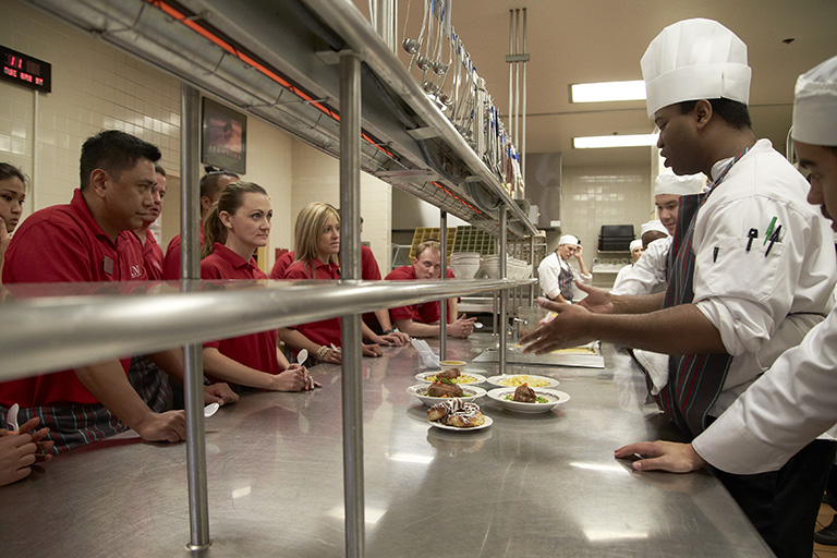 Hotel College culinary students work in the Boyd Dining Room kitchen during their capstone class