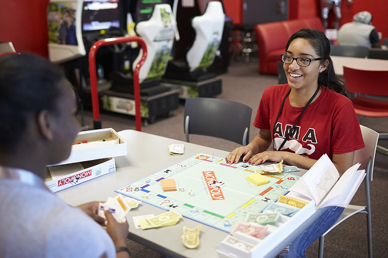 Students playing Monopoly.