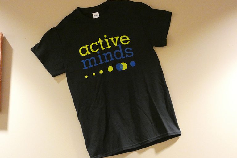 T-shirt for the active minds organization mounted on a wall.