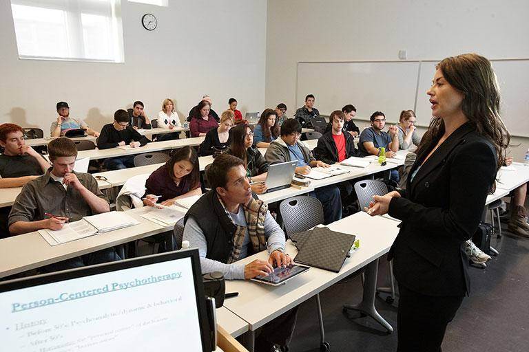Students sitting in presentation room listening to presenter.