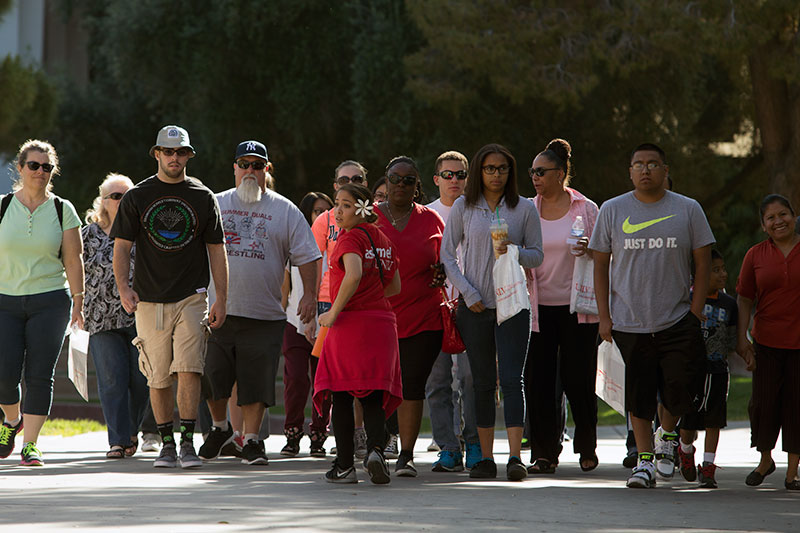 A group walks on campus during a tour