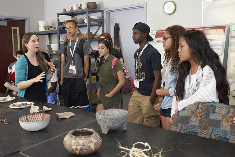 Students observing artifacts