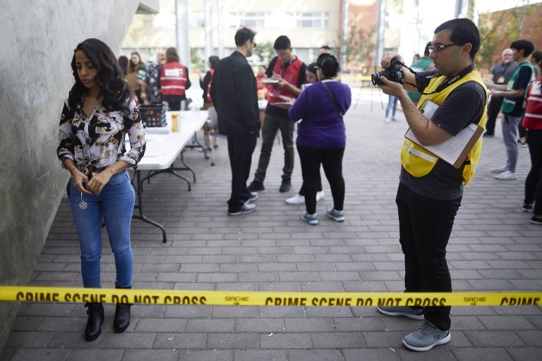 Person taking photo of a crime scene