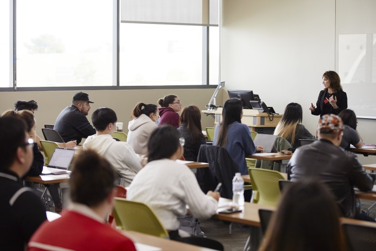 Woman talking in front of class