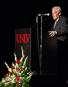 Jack A. Rappaport Speaking into a microphone on a UNLV stage