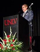 Paul Curtis Steelman speaking behind a UNLV podium