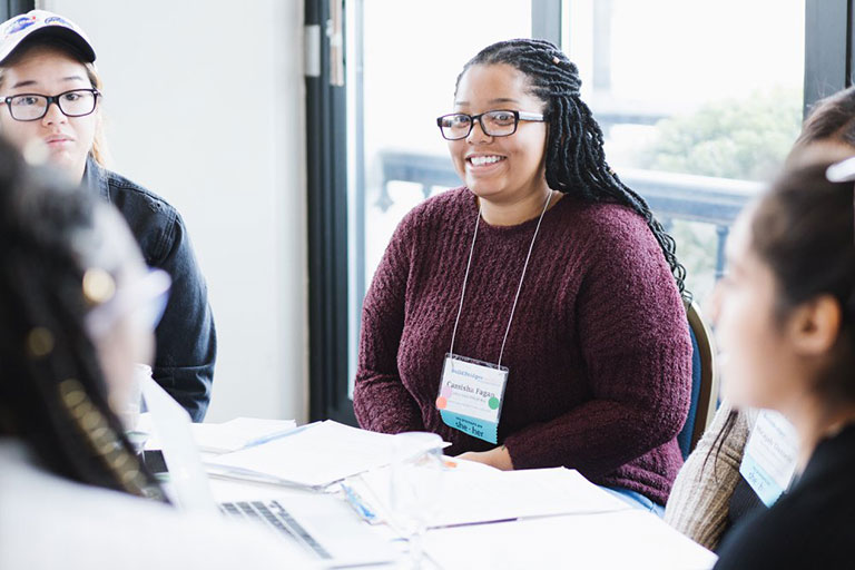 Camisha Fagan and other participants of the 2018-19 Grad Rebel Advantage Program