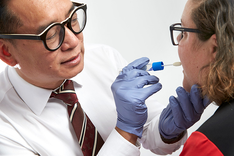 A doctor examining a patient's mouth