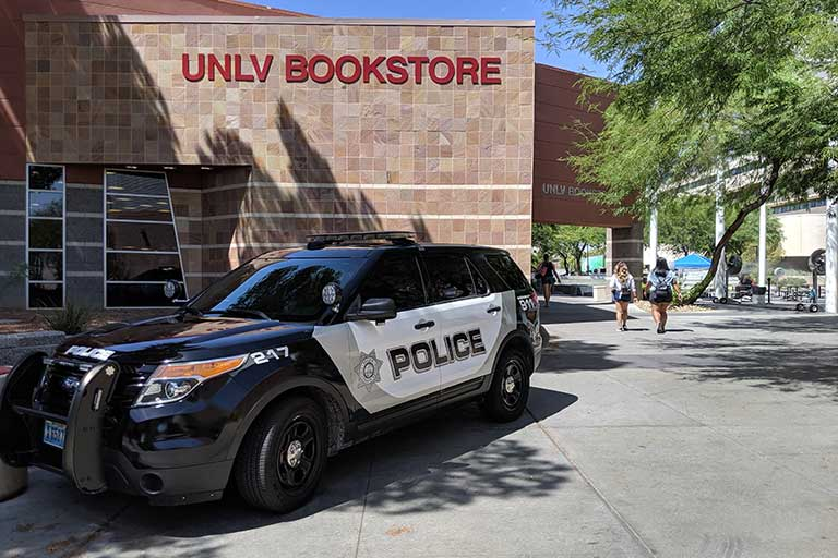 Police vehicle next to bookstore