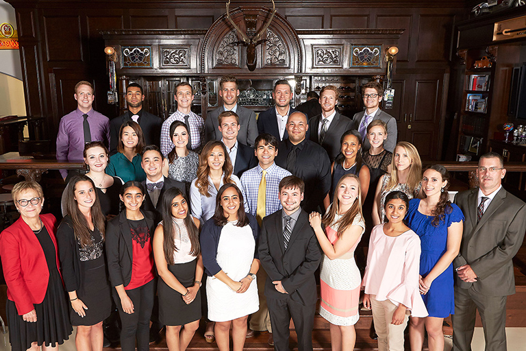 Sean McGarry, center, represented the Engelstad Family Foundation to meet the first 25 Engelstad Medical Scholars
