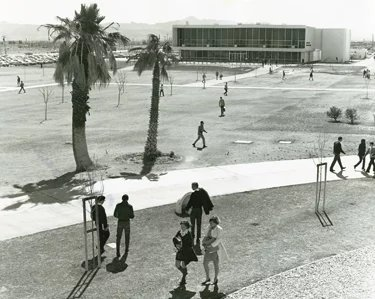 Students walking across the quad in front of the 1970s Union