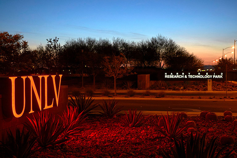 UNLV sign with technology park in the background