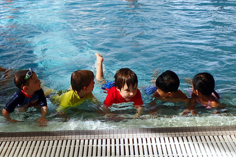 Group of children swimming