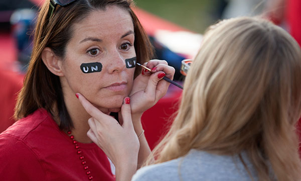 A woman getting her face painted