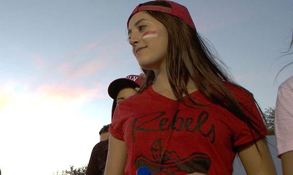 A student wearing Rebel gear