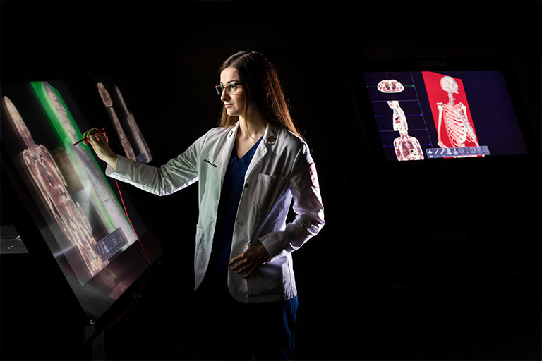 Sierra Mastrantonio, a charter class graduate student, in the Med School Virtual Anatomy Lab