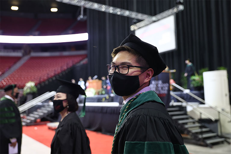 Charter Class graduate student, Toyokazu (Chris) Endo, at the Commencement and Academic Hooding Ceremony
