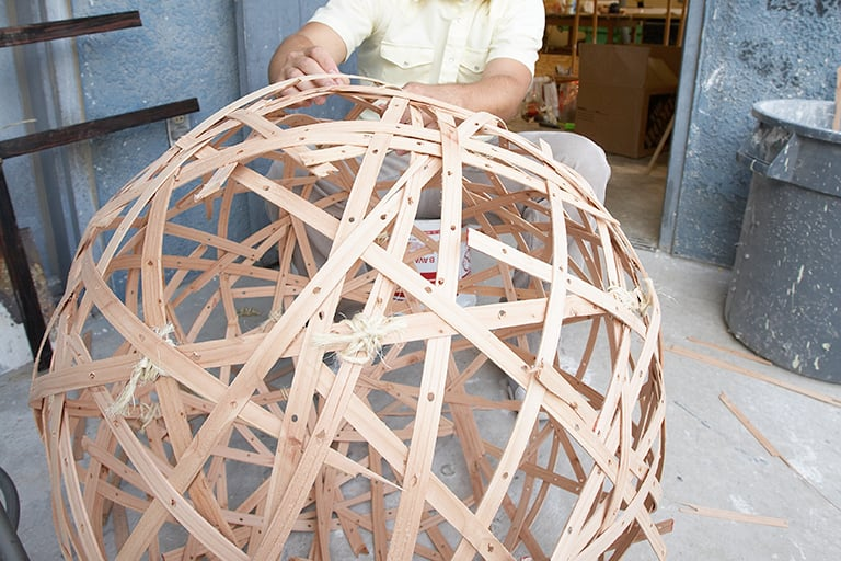 A student building a 3d ball out of wood.