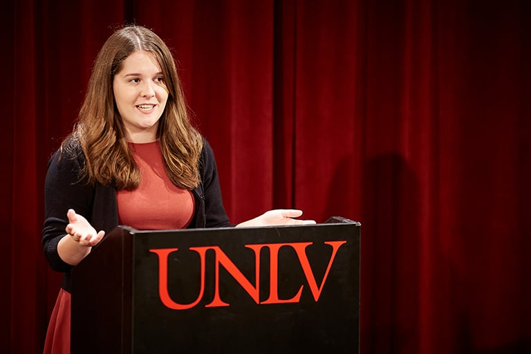 UNLV female student at the debate podium.
