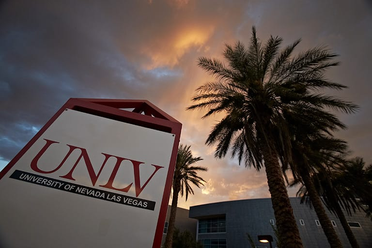 UNLV sign with sunset in the background