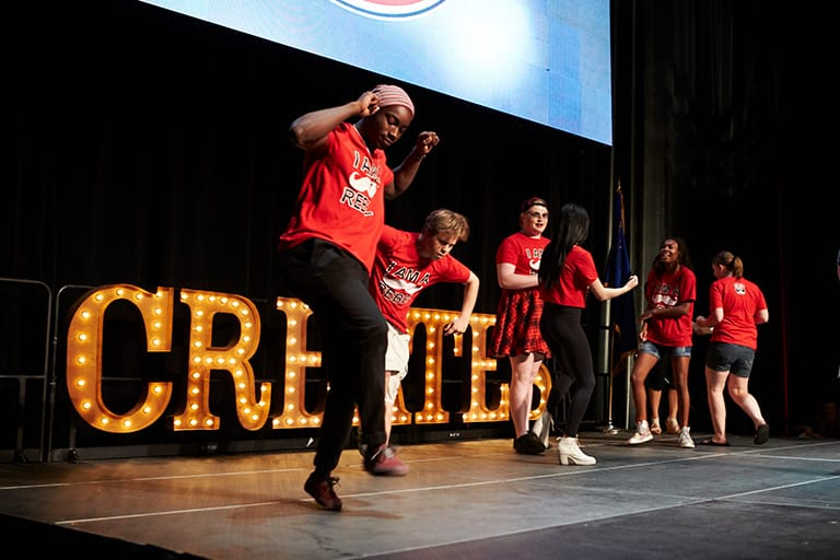 Students dance on stage during UNLV Creates
