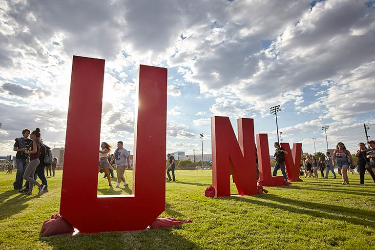 Large U-N-L-V letters displayed at an event