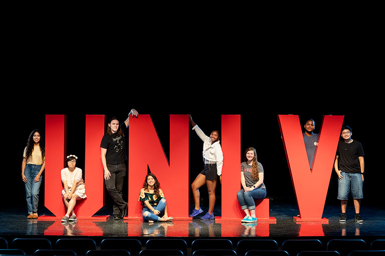 Students posing with large red U-N-L-V letters
