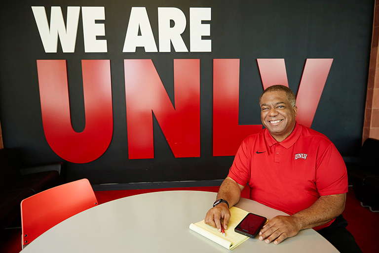 U-N-L-V President Keith Whitfield under We Are U-N-L-V sign