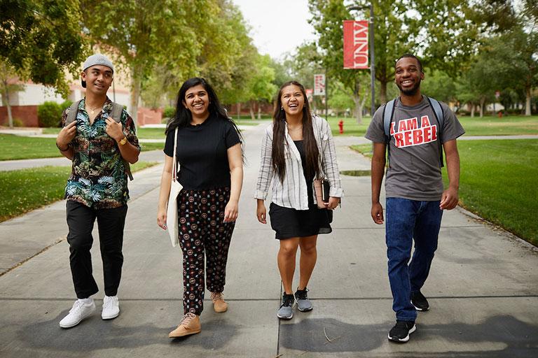 Students walking toward the camera