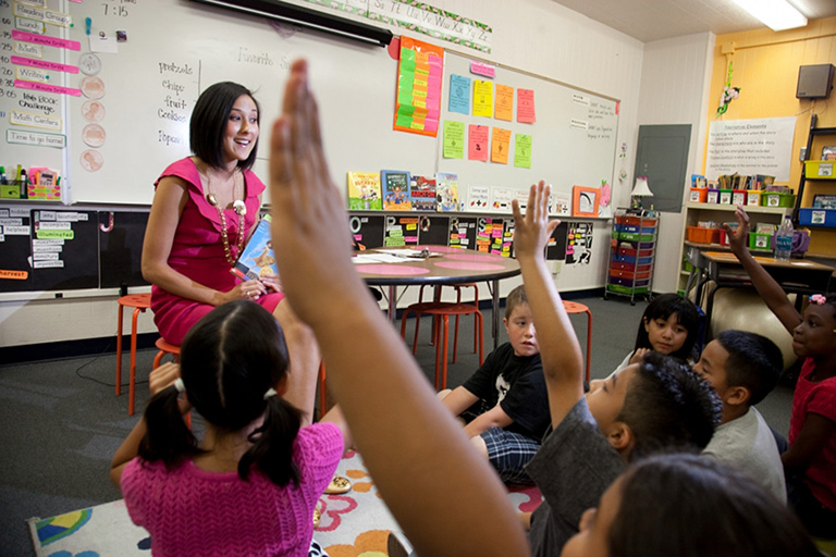 A Teach For America Las Vegas Valley corps member works with students at Goldfarb Elementary in Las Vegas.