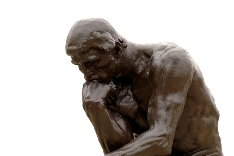 A bronze sculpture of The Thinker.