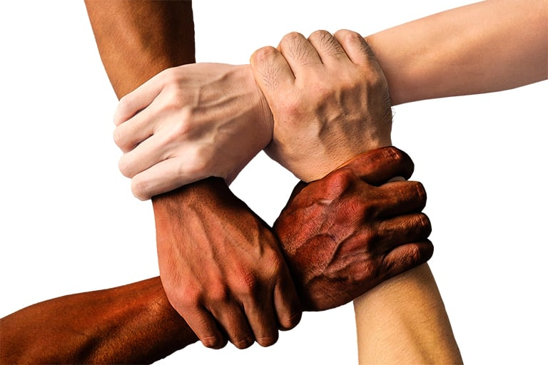 Hands united together from different cultures.