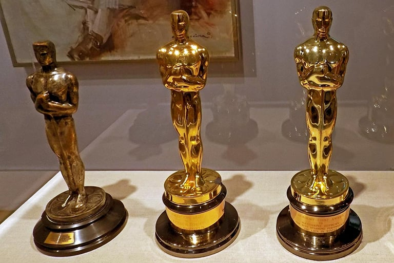 Several golden Oscar awards from different years.