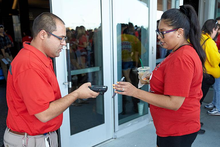 Ticket taker scanning tickets