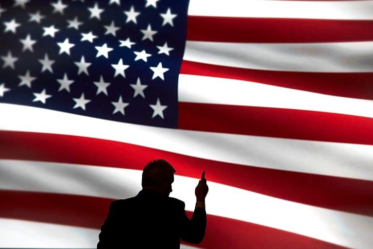 Politician speaks in front of U.S. flag