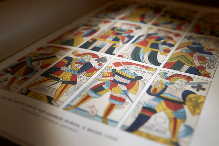 Historical book opened to page with artwork