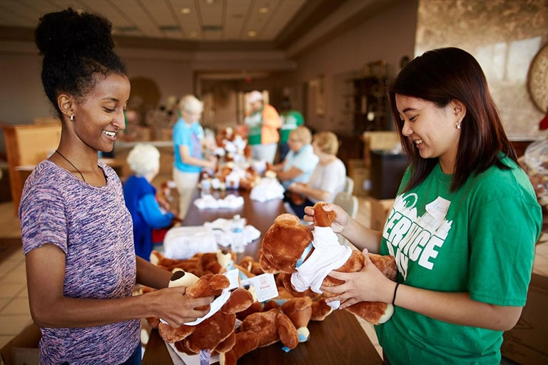 Students stuffing  bears for Service Day
