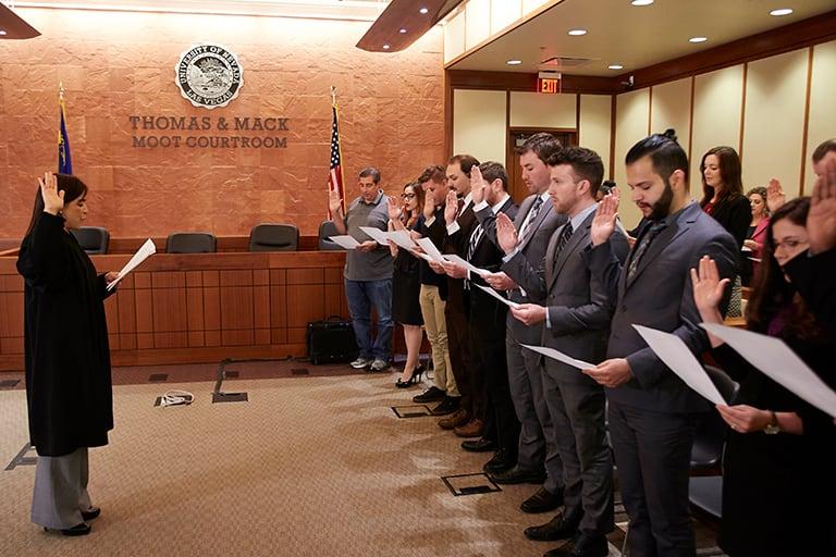 Group of people being sworn in