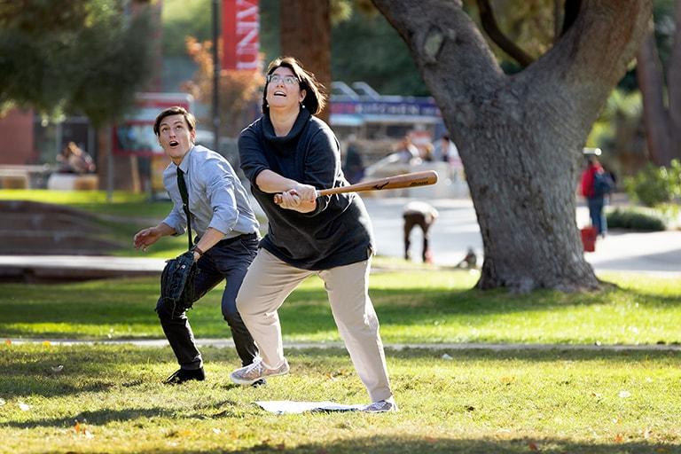 Two people playing baseball