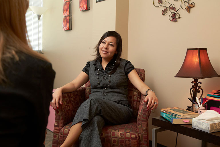 Female counselor speaking to a patient