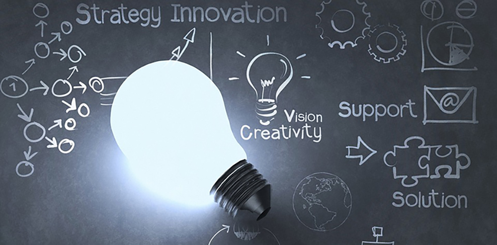 The words strategy innovation, vision creativity, support, and solution surrounding a lightbulb