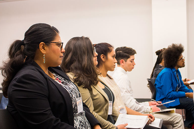 A group of students paying attention to a presentation.