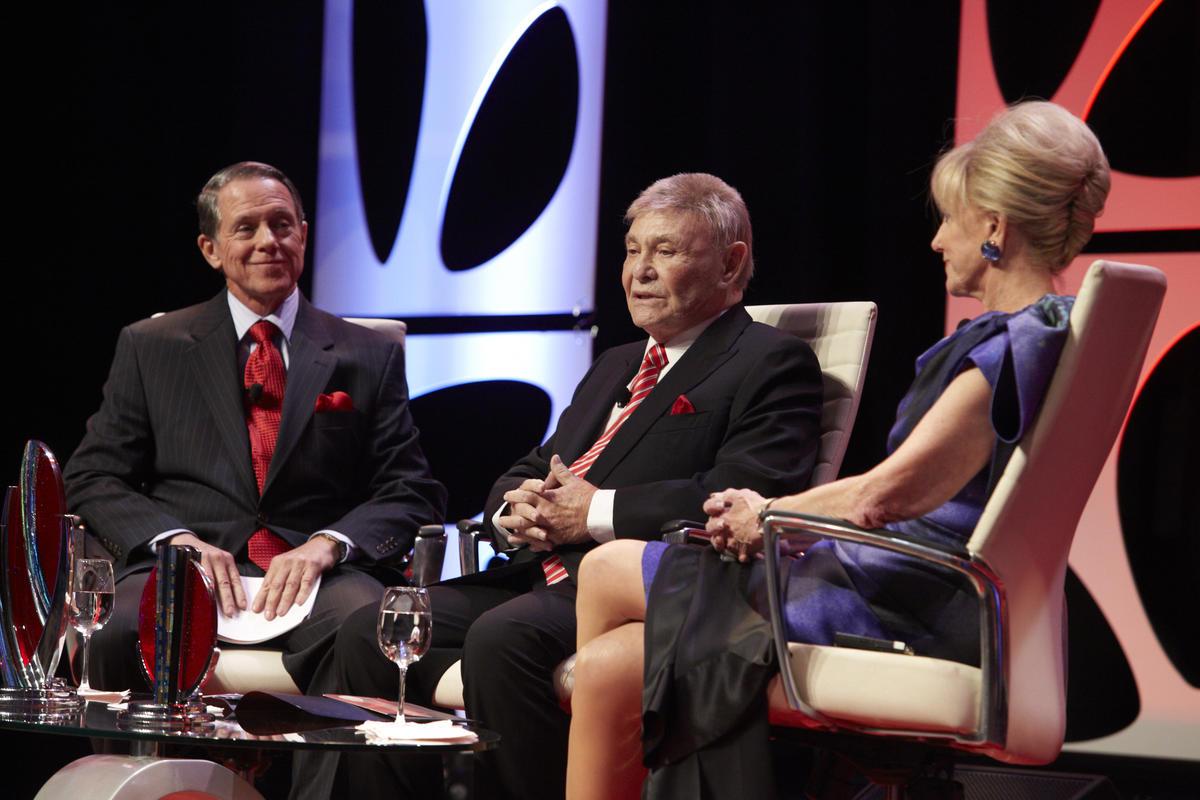 John O'Reilly, Irwin Molasky, and Elaine Wynn present on Annual Dinner stage.