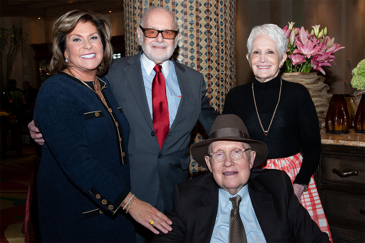 Lexy and Sam Lionel pose for a photograph with Senator Harry Reid (seated) with his wife, Landra.