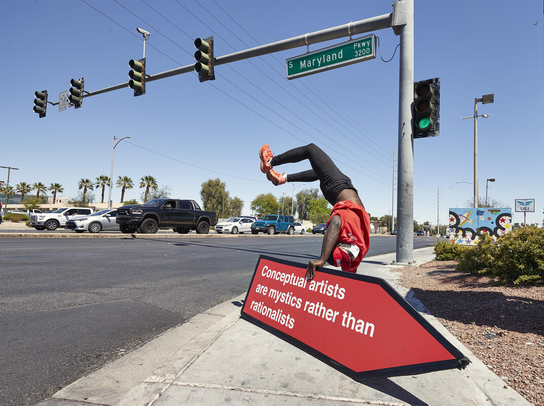 Sign Spinner Evan James performs on the corner of Maryland Parkway