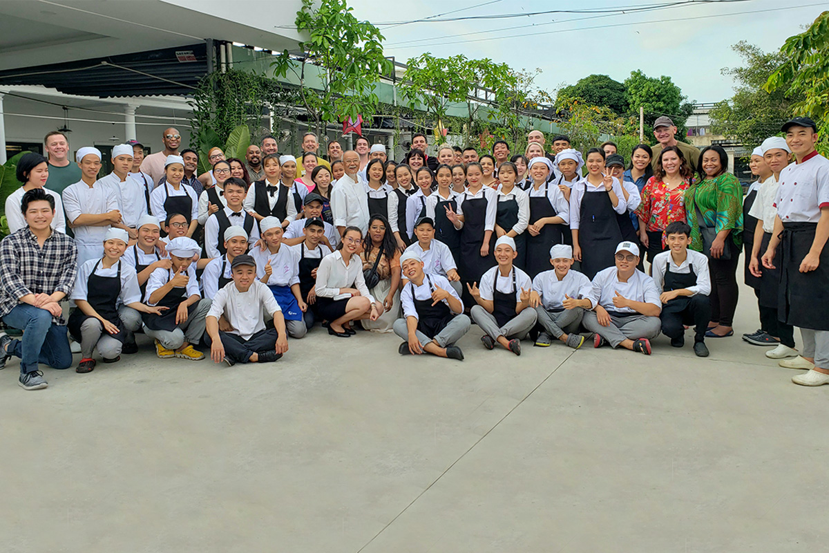 Picture of Tifferney and Cohort 17 with students of the Andre Mai Sen Vocational School