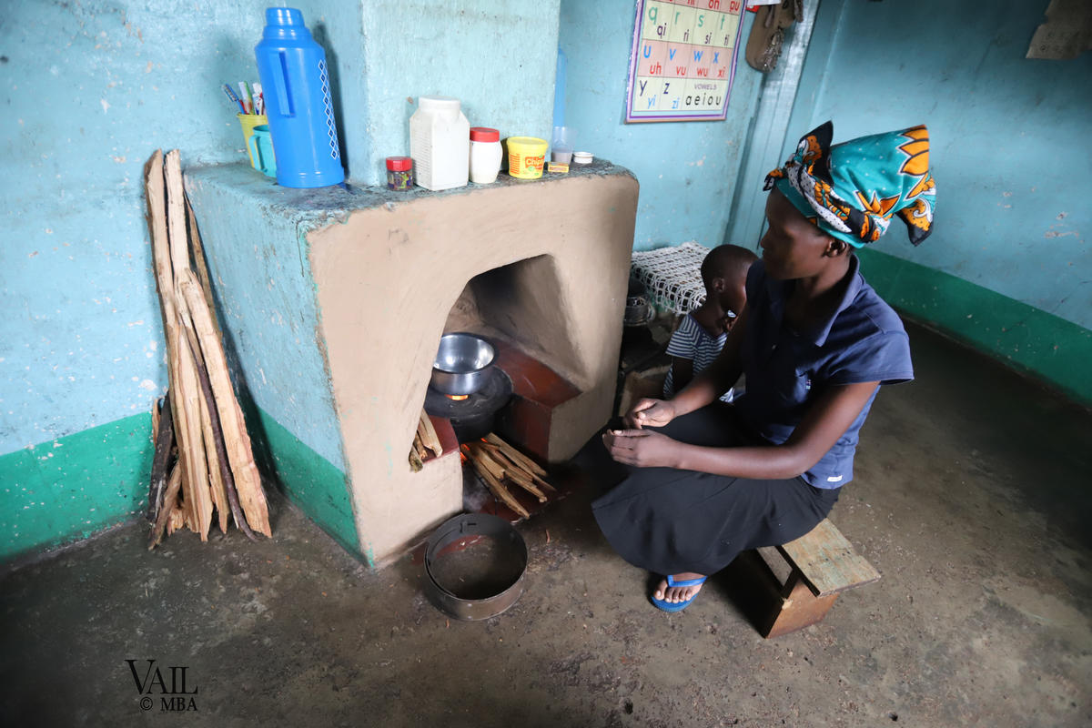 Photo of woman using a cookstove.