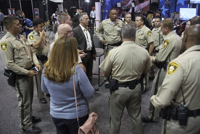 Sheriff Joseph Lombardo of the Las Vegas Metropolitan Police Department (center in suit) leads a meeting of officers before the 2016 Presidential Debate at UNLV. He is a graduate of UNLV's master of science in executive crisis and emergency management program. (Josh Hawkins/UNLV Creative Services)