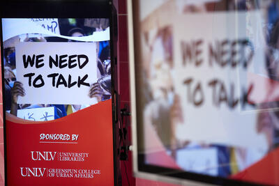 A picture of a sign which says We Need to Talk